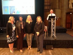Left to right: Laura Daniels (Woodheys Primary), Opal Walsh (Urmston Junior), Amanda Topson (Trafford Baha'i Community), Jane Bryan (Trafford SACRE Adviser), and Lat Blaylock (RE Today Editor, on podium)